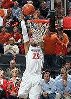 Virginia forward Akil Mitchell (25) dunks the ball during the game against North Carolina  at the John Paul Jones arena in Charlottesville, Va. Virginia defeated North Carolina 61-52.