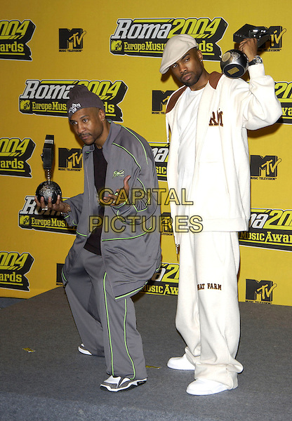 D12.KUNIVA & PROOF.MTV Europe Music Awards 2004,.Tor di Valle, Rome, Italy, 18th November 2004..full length trophy award  grey tracksuit hat cap funny.Ref: PL.www.capitalpictures.com.sales@capitalpictures.com.©Capital Pictures.