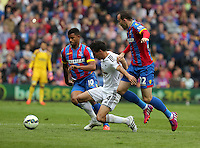 Pictured: Jack Cork of Swansea (C) is brought down by Fraizer Campbell (L) and Jordon Mutch (R) of Crystal Palace<br />
