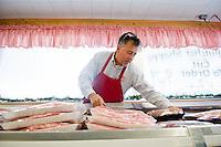 Owner Artie Elias, stacks meat at his butcher Shop in Roanoke Rapids, North Carolina.