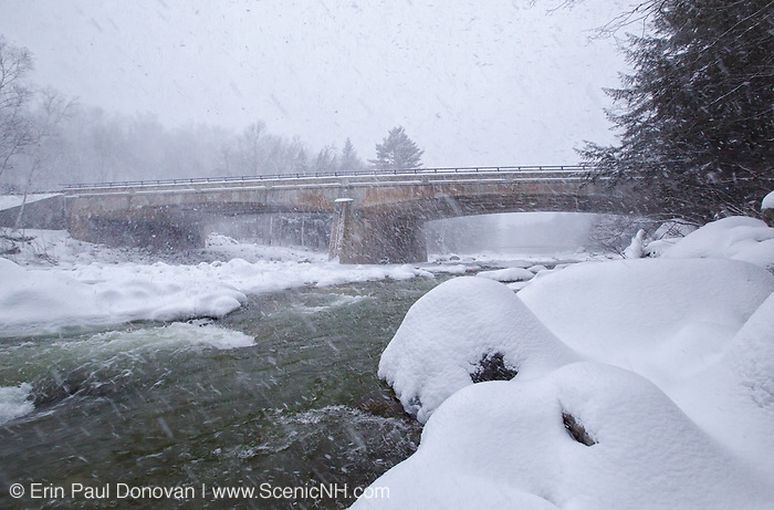 Kancamagus Scenic Byway - Route 112 bridge in the winter months during a snow storm. This bridge crosses the East Branch of the Pemigewasset River in Lincoln, New Hampshire USA