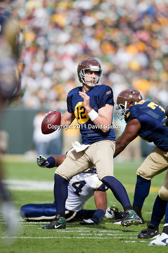 Green Bay Packers quarterback Aaron Rodgers (12) looks for a receiver during a Week 6 NFL football game against the St. Louis Rams on October 16, 2011 in Green Bay, Wisconsin. The Packers won 24-3. (AP Photo/David Stluka)