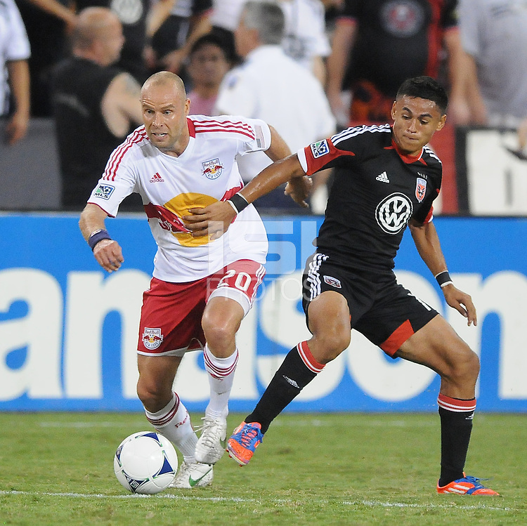 New York Red Bulls midfielder Joel Lindpere (20) shields the ball form D.C. United defender Andy Najar (14) The New York Red Bulls tied D.C. United 2-2 at RFK Stadium, Wednesday August 29, 2012.
