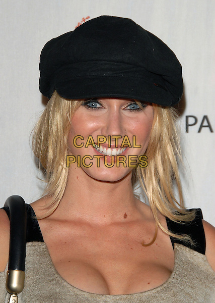 KIMBERLY STEWART.Sophie Albou's Paul & Joe Collection for The Opening of Target Temporary Boutique on Melrose in Beverly Hills, California, USA..July 27th, 2006.Ref: DVS.headshot portrait black hat cleavage.www.capitalpictures.com.sales@capitalpictures.com.©Debbie VanStory/Capital Pictures