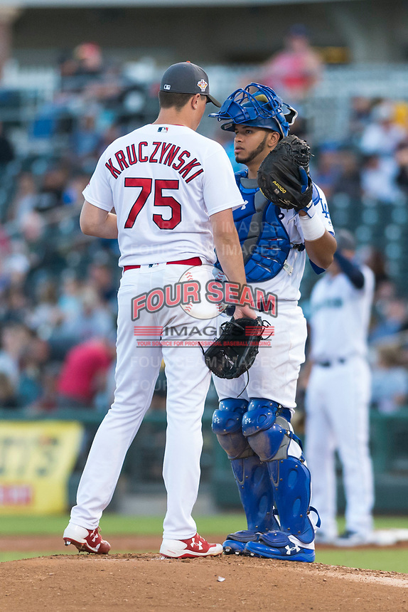AFL West catcher Keibert Ruiz (17), of the Glendale Desert Dogs and Los Angeles Dodgers organization, talks to relief pitcher Evan Kruczynski (75) on the mound during the Arizona Fall League Fall Stars game at Surprise Stadium on November 3, 2018 in Surprise, Arizona. The AFL West defeated the AFL East 7-6 . (Zachary Lucy/Four Seam Images)