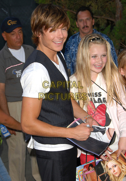 ZAC EFRON.attends The Fox Teen Choice Awards 2007 held at Universal Ampitheatre in Universal City, California, USA, August 26th 2007.       .half length waistcoat signing autograph.CAP/DVS.©Debbie VanStory/Capital Pictures