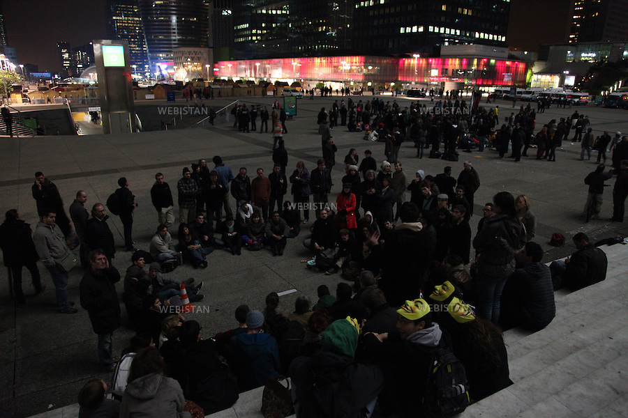 FRANCE.PARIS. 5/11/2011: The indignant people of France called for  occupying La Defense, the business district near Paris on Friday 4 of November. Many people gathered together around five o'clock in the afternoon of that day, hoping to be able to put up their tents. later that night the police took all the tents and materials and asked them to leave. Many people stayed and some returned on Saturday the 5th with their sleeping bags. They hold their general assemblies and started to organise their working group to plan the rest of their stay in La Defense.