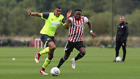 Colin Quaner of Huddersfield Town tries to shake off a challenge from Brentford's Moses Odubajo during Brentford B vs Huddersfield Town Under-23, Friendly Match Football at Brentford FC Training Ground, Jersey Road on 12th September 2018