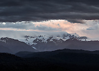 Dramatic, moody sunset over Southern Alps and Franz Josef Glacier viewed from Okarito lookout Westland Tai Poutini National Park, West Coast, South Westland, UNESCO World Heritage Area, New Zealand, NZ