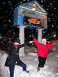 Nancy and her sister pose in the falling snow at a local landmark in Rehoboth Beach, Delaware, USA, (during the blizzard of February 2010).