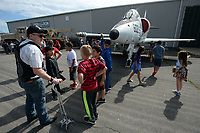 NWA Democrat-Gazette/ANDY SHUPE<br /> Volunteer Don Berndt answers questions Tuesday, May 14, 2019, about an A-4 Skyhawk on display for students from Lowell Elementary School as they tour the Arkansas Air and Military Museum in Fayetteville. The students spent the morning learning about flight and the history of aviation in Northwest Arkansas.