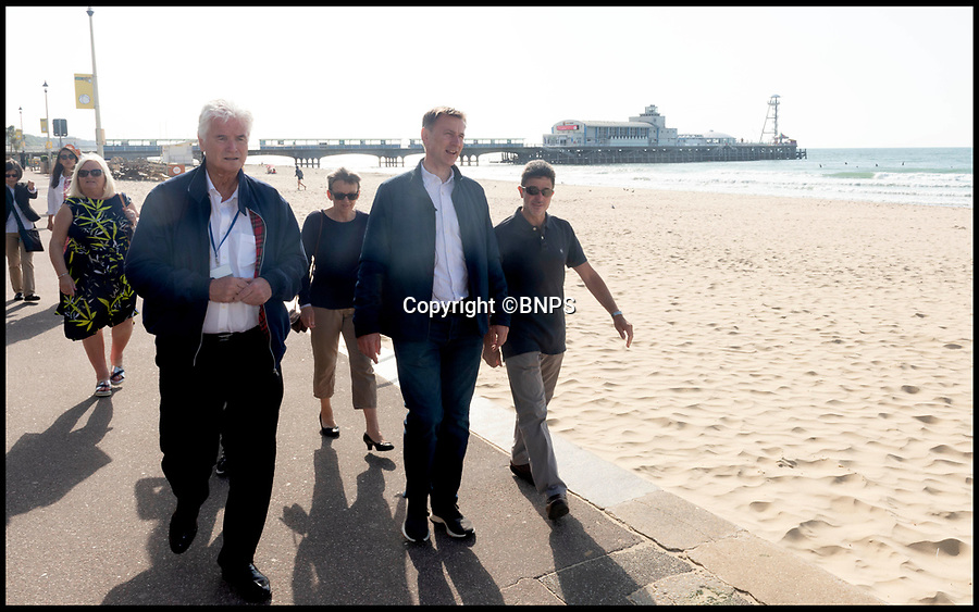 BNPS.co.uk (01202 558833)Pic:   RogerArbon/BNPS<br /> <br /> Jeremy Hunt walks along the promenade in Bournemouth this morning.  The PM candidate took a few minutes to speak to local people too.