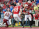 Wisconsin Badgers tight end Jake Byrne (82) is congratulated by teammates Lance Kendricks (84) and Brian Wozniak (49) during an NCAA college football game against the Indiana Hoosiers on November 13, 2010 at Camp Randall Stadium in Madison, Wisconsin. The Badgers won 83-20. (Photo by David Stluka)