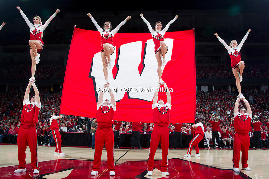Wisconsin Badgers cheerleaders perform during a Big Ten Conference NCAA college basketball game against the Illinois Fighting Illini on Sunday, March 4, 2012 in Madison, Wisconsin. The Badgers won 70-56. (Photo by David Stluka)