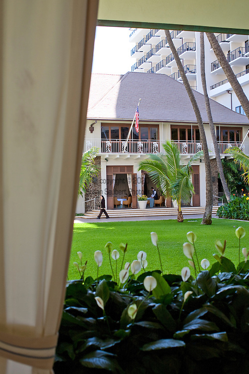 The Halekulani Hotel, the Hawaiian name meaning House Befitting Heaven, located on Waikiki beach in Honolulu, Hawaii offers stunning views of Diamond Head in a historic, secluded and exclusive setting. The Veranda where afternoon tea is served.