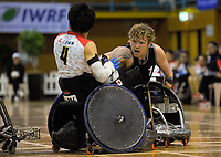 Camweron Leslie tries to get the ball off Masayuki Haga during the 2017 International Wheelchair Rugby Federation Asia-Oceania Zone Championships tournament match between the New Zealand Wheel Blacks and Japan at ASB Stadium in Auckland, New Zealand on Thursday, 31 August 2017. Photo: Dave Lintott / lintottphoto.co.nz