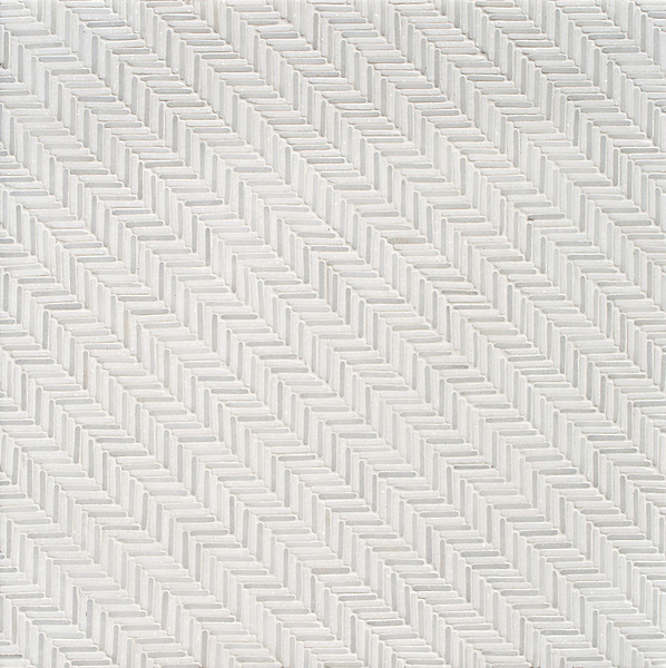 Tweed, a hand-cut tumbled mosaic, shown in Thassos and Afyon White, is part of the Tissé® collection for New Ravenna.
