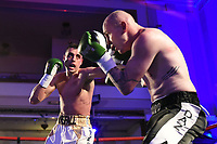 Sam Horsfall (white/gold shorts) defeats Darryl Sharp during a Boxing Show at the Camden Centre on 10th March 2018