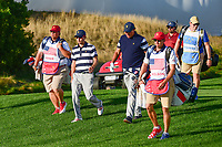 Kevin Kisner (USA) and Phil Mickelson (USA) make their way down 15 during round 1 foursomes of the 2017 President's Cup, Liberty National Golf Club, Jersey City, New Jersey, USA. 9/28/2017.<br /> Picture: Golffile   Ken Murray<br /> ll photo usage must carry mandatory copyright credit (&copy; Golffile   Ken Murray)