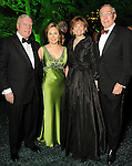 From left: Rich and Nancy Kinder with Bobbie and John Nau at the Gala on the Green benefitting the Discovery Green Conservancy Saturday Feb. 27,2010. (Dave Rossman Photo)