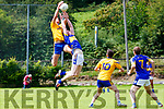 Michael McCarthy Spa claims the ball over Kieran Murphy Glenflesk as Cormac Cronin Spa and Brian O'Donoghue Glenflesk ready to pounce during their County League clash on Sunday