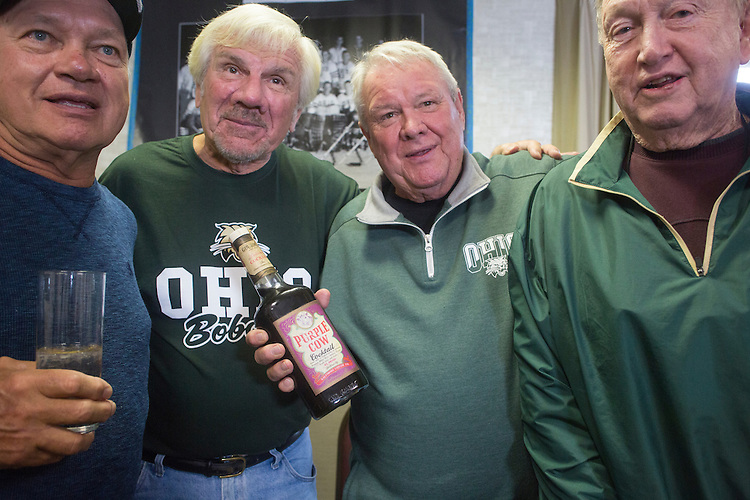 Left to right, Tom Gosiorowski, Joe Zieleniewski, Bing Carlson, and Al Haines pose with a bottle of Purple Cow Cocktail during the 1960s hockey alumni reunion at the OU Inn on October 1, 2016.