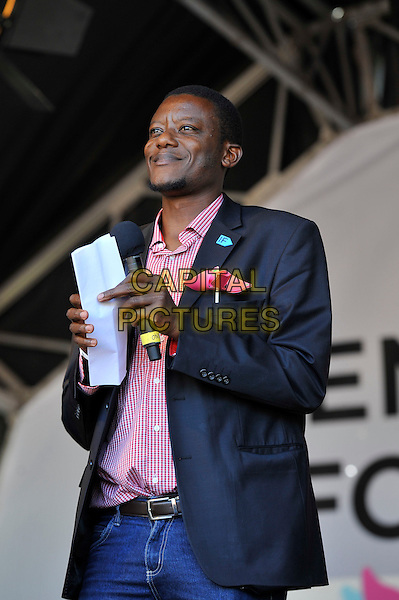 Alvin Mosioma <br /> attending The Big IF, Hyde Park, London, England. <br /> 8th June 2013<br /> half length black suit jacket pink short stage<br /> CAP/MAR<br /> &copy; Martin Harris/Capital Pictures
