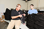 September 18, 2014. Raleigh, North Carolina.<br />  Chuck Sawyer's stores screen print 1000's of t-shirts a week when busy. Here he checks the screen on some shorts with employee Tony Rakes in the production part of his main store.<br />  Chuck Sawyer, 37, is the owner of three Instant Imprints franchises, specializing in promotional materials such as t-shirts,signs and mugs. Sawyer wishes he had more saved for retirement and is encouraging his none employees to start thinking about how they will save for when they get older.<br /> Publication: AARP Bulletin<br /> Editor: Jenna Isaacson-Fuller<br /> Model Released<br /> Portrait