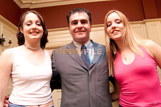 Tracey Finlay, Moran's Terrace and Renee Tallon, Clogherhead with compere Paul Maguire at the Young Miss Drogheda competition in the Westcourt Hotel..Picture: Paul Mohan/Newsfile