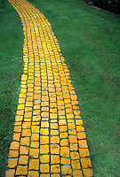 Yellow Brick pathway through lawn grass, like Wizard of Oz, magical journey, magical walk, storybook stepping stones, real, nature