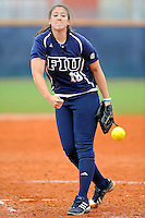 11 February 2012:  FIU's Jenn Gniadek (18) pitches as the University of Louisville Cardinals defeated the FIU Golden Panthers, 4-2, as part of the COMBAT Classic at the FIU Softball Complex in Miami, Florida.