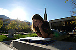 1003-13  GCS Sunrise..10/7/03..Photo by Jaren Wilkey/BYU..Girl Studying in front of the JSB Joseph Smith Building