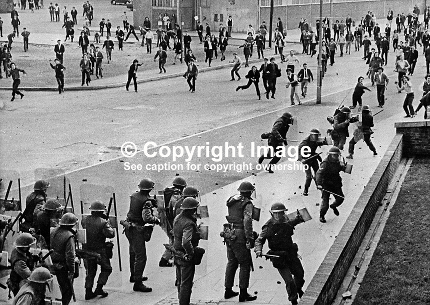 Rioters and British soldiers clash in the Bogside area of Londonderry, N Ireland, UK, following republican parade, 11th April 1971. 197104110558<br /> <br /> Copyright Image from Victor Patterson, 54 Dorchester Park, Belfast, UK, BT9 6RJ<br /> <br /> t1: +44 28 9066 1296<br /> t2: +44 28 9002 2446<br /> m: +44 7802 353836<br /> <br /> e1: victorpatterson@me.com<br /> e2: victorpatterson@gmail.com<br /> <br /> www.victorpatterson.com<br /> <br /> IMPORTANT: Please see my Terms and Conditions of Use at www.victorpatterson.com