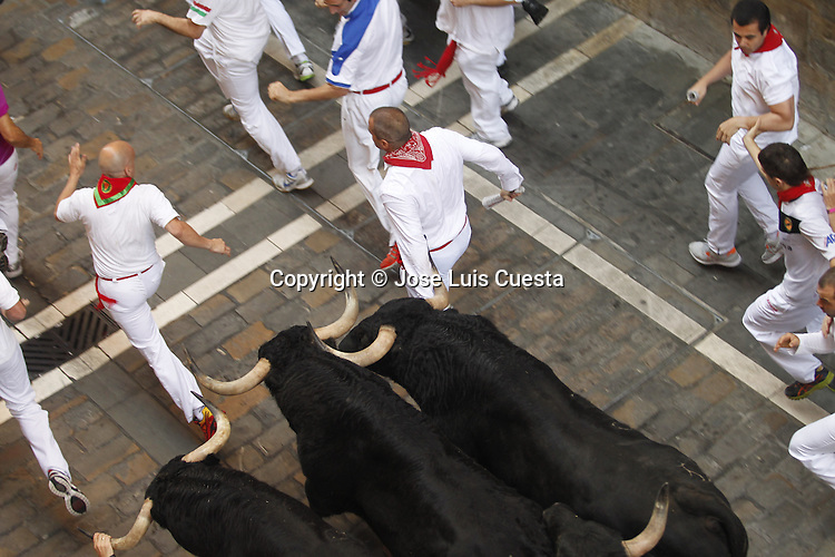 Third day of bull run in Estafeta street, Pamplona, northern of Spain.  San Fermin festival is worldwide known because the daily running bulls.