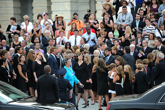 "Vicki Kennedy (center), the widow of former U.S. Senator Edward ""Teddy"" Kennedy, is accompanied by members of the Kennedy family in front of the U.S. Senate in Washington, D.C. on August 29, 2009.  The Kennedy family stopped briefly in front of the U.S. Capitol to thank his legislative aids and fellow legislators for their partnership during his years in the U.S. Senate in addition to a moment for prayer and remembrance en route to Arlington National Cemetery in Arlington, Va."
