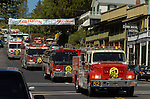 September 20, 2004 Angels Camp, California -- Tuolumne Fire –- Fire engines from Oakdale City, Oakdale Rural, and Ceres Fire Departments travel through downtown Angels Camp to honor fallen firefighter Eva Marie Schicke whose memorial service was held at the Calaveras County Fairgrounds. The Tuolumne Fire was a small very fast-moving fire that started around noon on September 12, 2004 near Lumsden Bridge at the bottom of the Tuolumne River.  The fire moved rapidly up the 80-plus-degree slope catching Cal Fire Helitack firefighters, tragically killing firefighter Eva Marie Schicke and injuring five others.