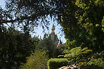 DISNEYLAND ATTRACTION, TREES SURROUND SLEEPING BEAUTY CASTLE