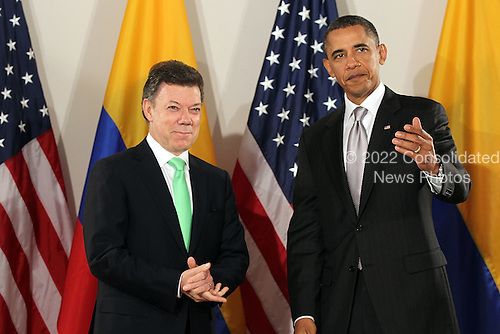 United States President Barack Obama (R) attends a bilateral meeting with President Juan Manuel Santos Calderon of Colombia, Friday, September 24, 2010 in New York City. Obama has been in New York since Wednesday attending the annual General Assembly at the United Nations, where yesterday he stressed the need for a resolution between Israel and Palestine, and a renewed international effort to keep Iran from attaining nuclear weapons.  .Credit: Spencer Platt - Pool via CNP