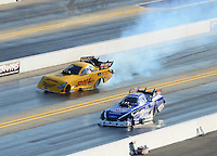 Apr. 13, 2012; Concord, NC, USA: NHRA funny car driver Jeff Arend (top) gets sideways alongside Robert Hight during qualifying for the Four Wide Nationals at zMax Dragway. Mandatory Credit: Mark J. Rebilas-