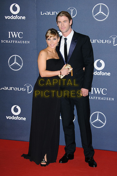 Elsa Pataky and Chris Hemsworth.Arrivals at the Laureus 2012 World Sports Awards held at the Queen Elizabeth II Centre, London, England..February 6th, 2012.full length black tuxedo dress married husband wife .CAP/CJ.©Chris Joseph/Capital Pictures.