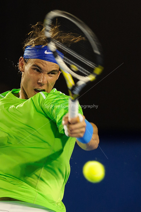 MELBOURNE, 29 JANUARY - Rafael Nadal (ESP) in action against Novak Djokovic (SRB) during the men's finals match on day 14 of the 2012 Australian Open at Melbourne Park, Australia. (Photo Sydney Low / syd-low.com)