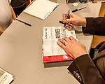 "July 26, 2017. Raleigh, North Carolina.<br /> <br /> Alan Gratz signs books after his author's talk. <br /> <br /> Author Alan Gratz spoke about and signed his new book ""Refugee"" at Quail Ridge Books. The young adult fiction novel contrasts the stories of three refugees from different time periods, a Jewish boy in 1930's Germany , a Cuban girl in 1994 and a Syrian boy in 2015."