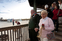 Love at Lovers Key. Thirty-two couples take part in first annual Renewal of Vows at Lovers Key State Park, Fort Myers Beach, Florida. George and Carol Lowery walk to the beach side ceremony. Photo by Debi Pittman Wilkey