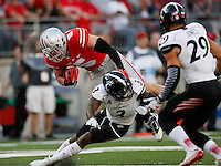 Ohio State Buckeyes tight end Jeff Heuerman (5) falls over Cincinnati Bearcats defensive back Howard Wilder (3) in the 1st quarter of a football game between The Ohio State Buckeyes and the University of Cincinnati Bearcats on Saturday, September 27, 2014 at Ohio Stadium in Columbus. (Columbus Dispatch photo by Fred Squillante)