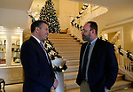Nevada Gov. Brian Sandoval, left, talks to Nevada Department of Wildlife Director Tony Wasley during a holiday lunch for cabinet and staff members at the Governor's Mansion in Carson City, on Wednesday, Dec. 19, 2018. (Cathleen Allison/Las Vegas Review-Journal)