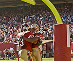 San Francisco 49ers tackle Derrick Deese (63) and wide receiver Tai Streets (89) celebrate touchdown on Sunday, October 27, 2002, in San Francisco, California. The 49ers defeated the Cardinals 38-28.