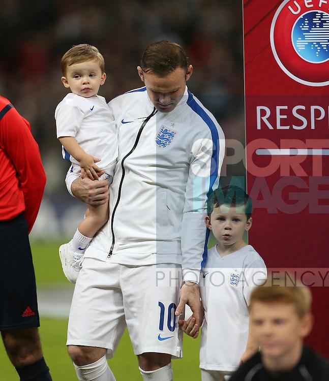 England's Wayne Rooney holds his sons Klay and Kai <br /> <br /> - International European Qualifier - England vs Slovenia- Wembley Stadium - London - England - 15th November 2014  - Picture David Klein/Sportimage