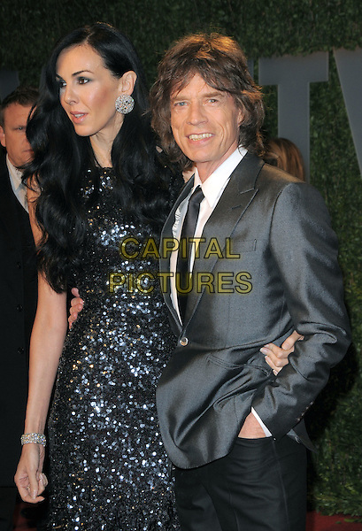 L'WREN SCOTT & MICK JAGGER.The 2009 Vanity Fair Oscar Party held at The Sunset Tower Hotel in West Hollywood, California, USA..February 22nd, 2009.oscars half length grey gray suit jacket black tie sequined sequins shiny sparkly dress beaded couple.CAP/DVS.©Debbie VanStory/Capital Pictures.