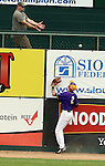 SIOUX FALLS, SD - MAY 24:  Brent Turner #2 from Western Illinois watches the ball bounce off the top of the left field wall as John Skrbec #11 from NDSU hit a grand slam in the first inning of the 2014 Summit League Baseball Championship game Saturday afternoon at the Sioux Falls Stadium. (Photo by Dave Eggen/Inertia)