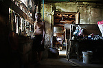 "KADEEJEEN, BANGKOK, THAILAND, DECEMBER 2012:..Local Houses in Kadeejeen where people works and lives, this kind of houses are called "" shop House "", Dec 2012..The Kadeejeen neighbourhood comprises six communities  Wat Kalaya, Kudeejeen, Wat Prayurawong, Wat Bupparaam, Kudee Khao and Roang Kraam...Ever since the Thonburi era (in the 17th Century), these historic neighbourhoods have maintained the diverse cultural heritage of three religions and four beliefs (Theravada Buddhism, Mahayana Buddhism, Christianity and Muslim) while coexisting in peaceful harmony...The neighbourhood is still characterised by Bangkok's traditional urbanism which is that of a fine-grained, religious establishment-centred urban structure with close-knit social cohesion. ©Giulio Di Sturco/Reportage by Getty Images.©Giulio Di Sturco/Reportage by Getty Images"